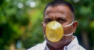 """رجل أعمال هندي يرتدي كمامة ذهبية للوقاية من """"كورونا"""""""